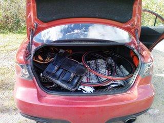 Cykel & portfölj. Bilen är tankad, packad & jag är glad på väg på konferens